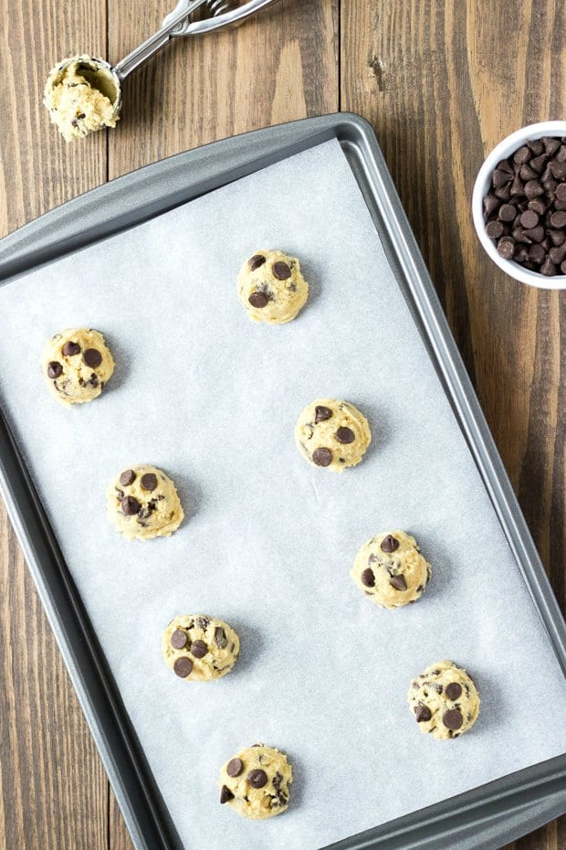 scoops of cookie dough on baking sheet