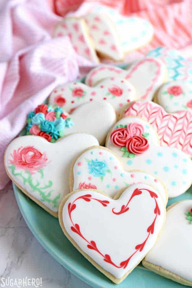 Looking for a great Valentine's Day sugar cookie recipe? These classic sugar cookies are decorated with royal icing in a variety of gorgeous Valentine's Day designs. They make wonderful edible gifts!