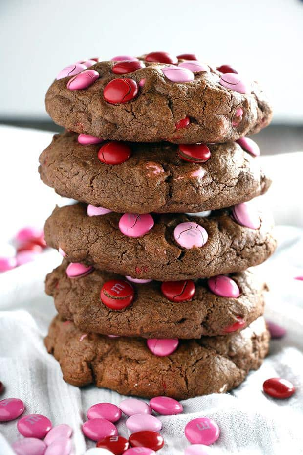 These big cookies are a chocolate lovers dream!  Super fudgey cookies that are soft and chocolatey in the middle and packed full of Valentine's Day M&M candies!