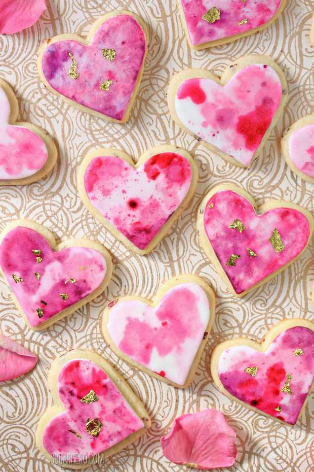 Watercolor Rose Sugar Cookies are gorgeous, romantic sugar cookies with a beautiful watercolor design. You'll be amazed at how simple it is to create the lovely watercolor patterns on the rose-flavored cookies!