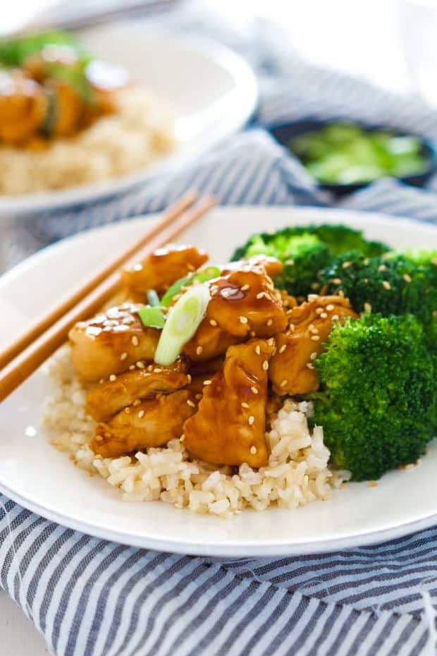 These delicious honey teriyaki chicken bowls are a super quick dinner! Tender chicken is sauteed until juicy and simmered in a homemade, healthy teriyaki sauce. Served with fresh veggies and rice, you will forget all about takeout!