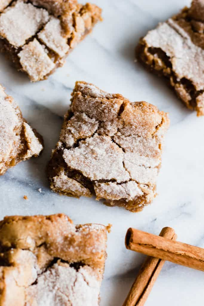 These cinnamon blondies are loaded with spicy cinnamon in every bite. Warm and gooey in the center, crackly on top, and dusted with a sprinkling of cinnamon sugar. These bars smell heavenly while baking, and taste even better!