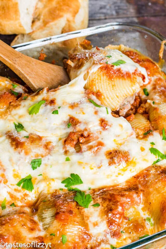 Seasoned Italian sweet sausage and beef mix together and fill these Sausage Stuffed Shells. Top with sauce and cheese for an unforgettable Italian casserole!