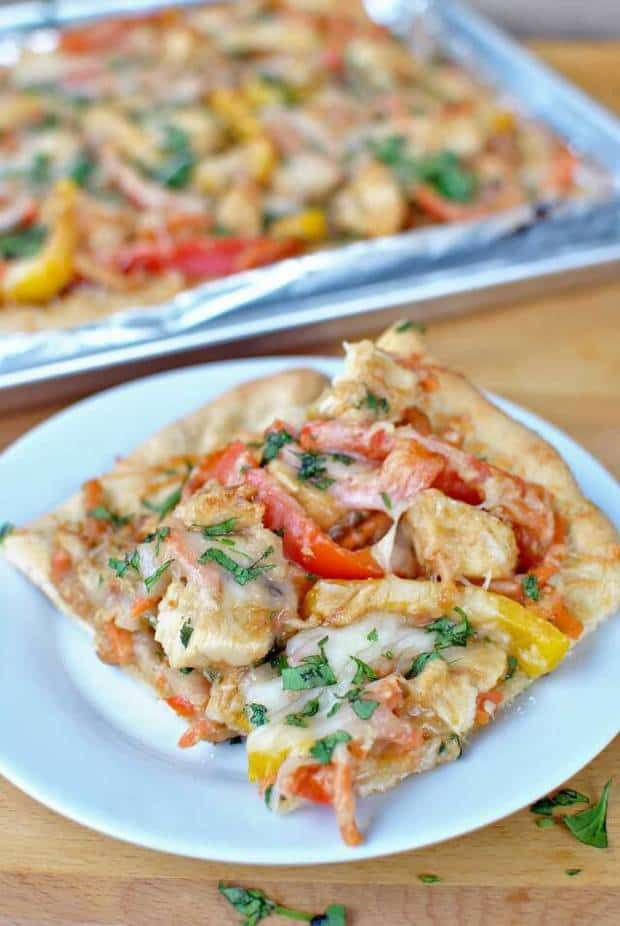 This Thai Chicken Pizza with Peanut Sauce has delicious chicken breast, peppers and cilantro that is then topped with a delicious peanut sauce! | Featured on The Best Blog Recipes