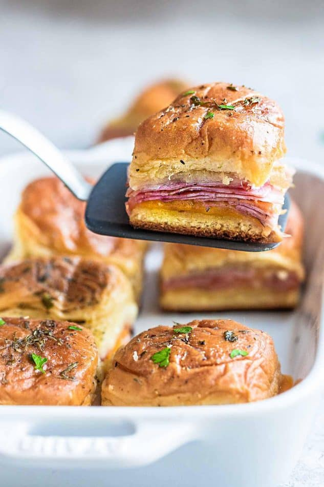 Ham and Cheese Sliders – perfect game day snacks and a great way for using up any leftover ham. Best of all, super easy to make with oven roasted ham, two cheeses and buttery garlic sauce over Hawaiian rolls.