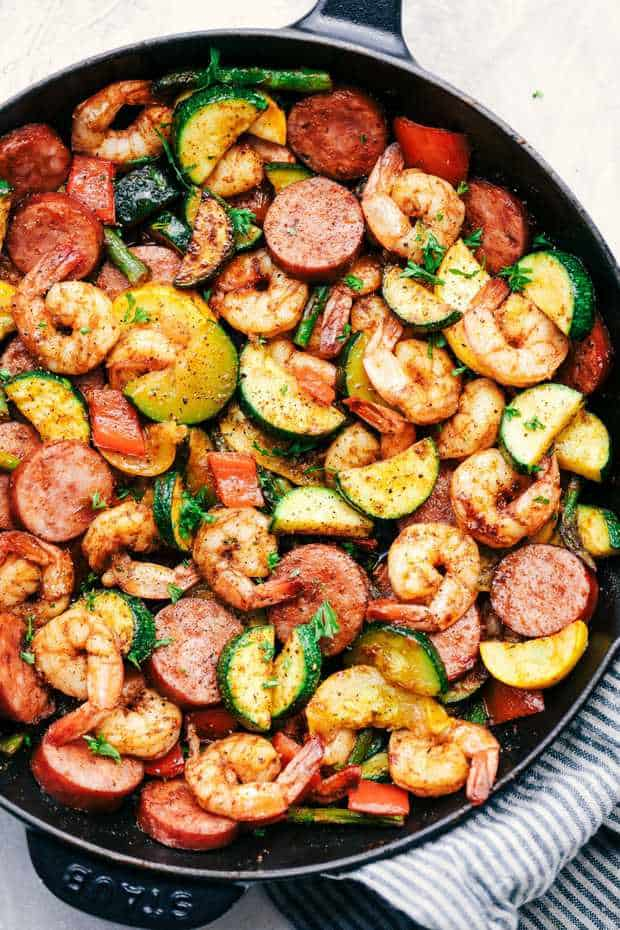 Cajun Shrimp and Sausage Vegetable Skilletis the BEST 20 minute meal packed with awesome cajun flavor with shrimp, sausage, and summer veggies. This makes a great low carb meal and is also great for meal prep!