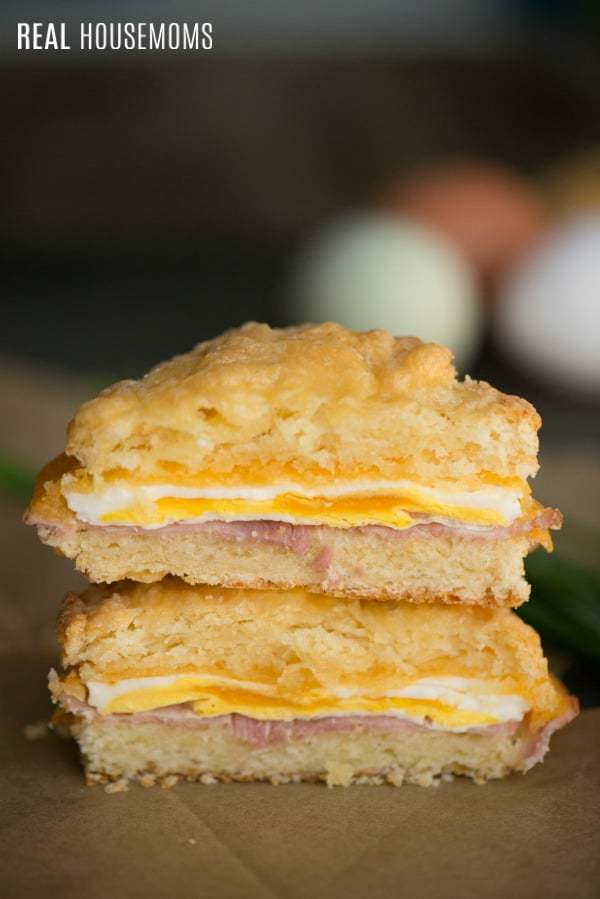 Ham Egg And Cheese Breakfast Sliders are a quick & easy breakfast that your entire family will love. Eggs topped with melted cheese on crispy ham inside a homemade biscuit is a great way to start your morning!