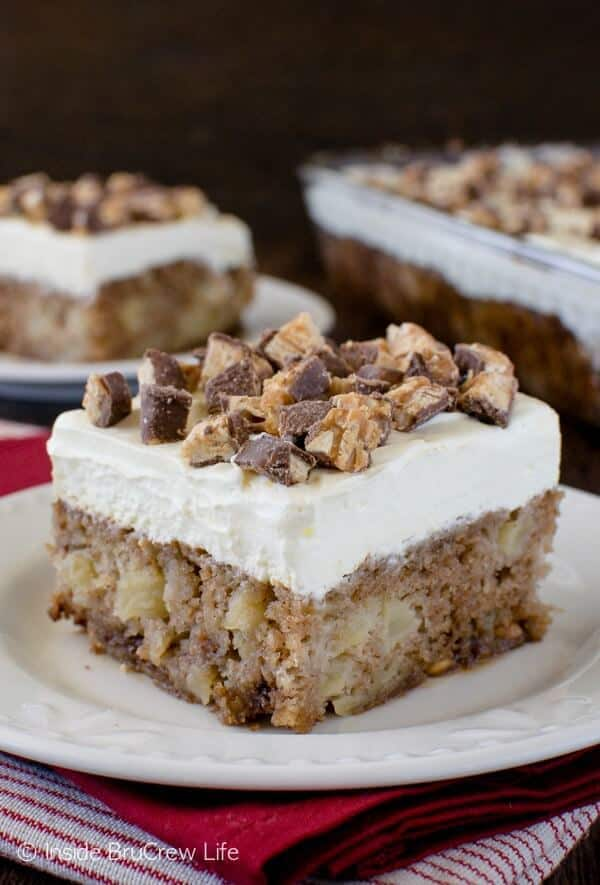 Snickers salad meets apple cake in this delicious dessert.  This Apple Snickers Cake is loaded with apples and candy bars and tastes amazing! Click below to watch the fun video of how to make it!