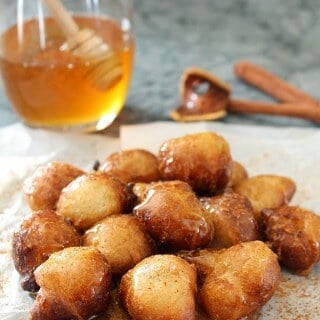 Have you had Loukoumades (Greek Doughnuts) before? I'm drooling just looking at them! They're simple dough balls served warm with cinnamon and honey/syrup. | Featured on The Best Blog Recipes