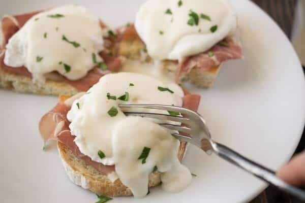 If you love Eggs Benedict, you should try this fun twist on the classic - Italian Eggs Benedict. Prosciutto, parmesan sauce and ciabatta are so delicious! | Featured on The Best Blog Recipes