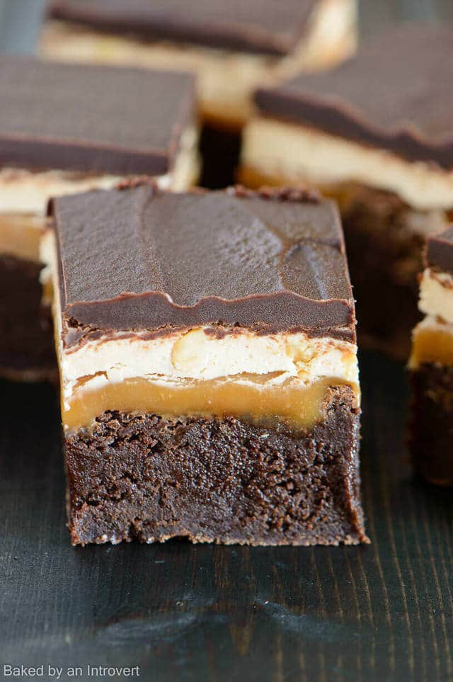 Combining brownies with a classic Snickers bar results in an incredible dessert experience. A thick triple chocolate brownie base, layered with gooey caramel, nutty marshmallow nougat, and topped with creamy chocolate.