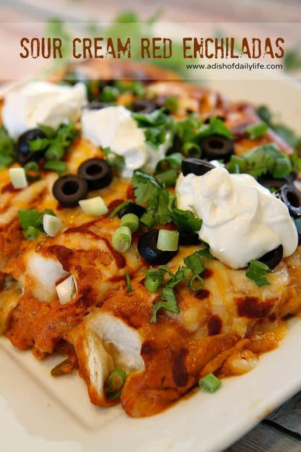 Do you love Mexican inspired recipes? Then give these Sour Cream Red Enchiladas a try. Cheesy, flavorful enchiladas the whole family will love! | Featured on The Best Blog Recipes