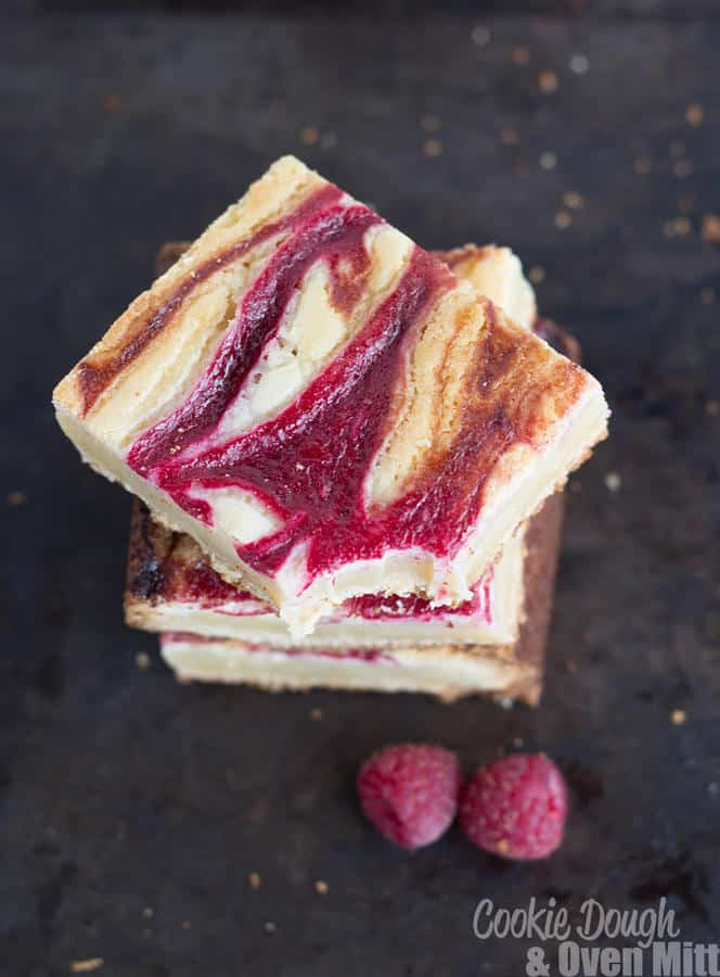 How could anyone say no to this dessert?! These Raspberry Swirled White Chocolate Blondies are absolutely gorgeous and yummy with a fresh raspberry swirl on top! | The Best Blog Recipes Contributor