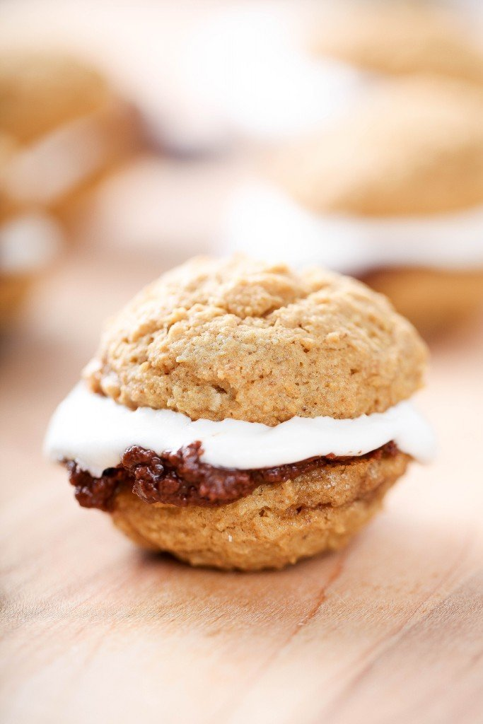 Smores Whoopie Pies: Sweet marshmallow buttercream and smooth milk chocolate sandwiched between 2 cake like cookies. If you like Smores you'll LOVE these!