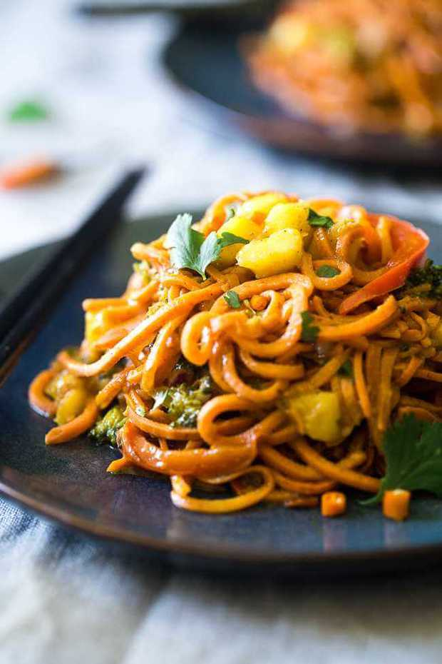 This Vegan Coconut Curry with Sweet Potato Noodles has the perfect balance of sweet coconut milk with JUST the right POP of flavor! | Featured on The Best Blog Recipes