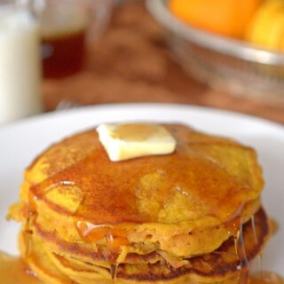 Who loves pumpkin? I love it all year long, so these Pumpkin Pancakes with Apple Cider Syrup are the perfect way to spruce up weekend brunch in my opinion! | Featured on The Best Blog Recipes