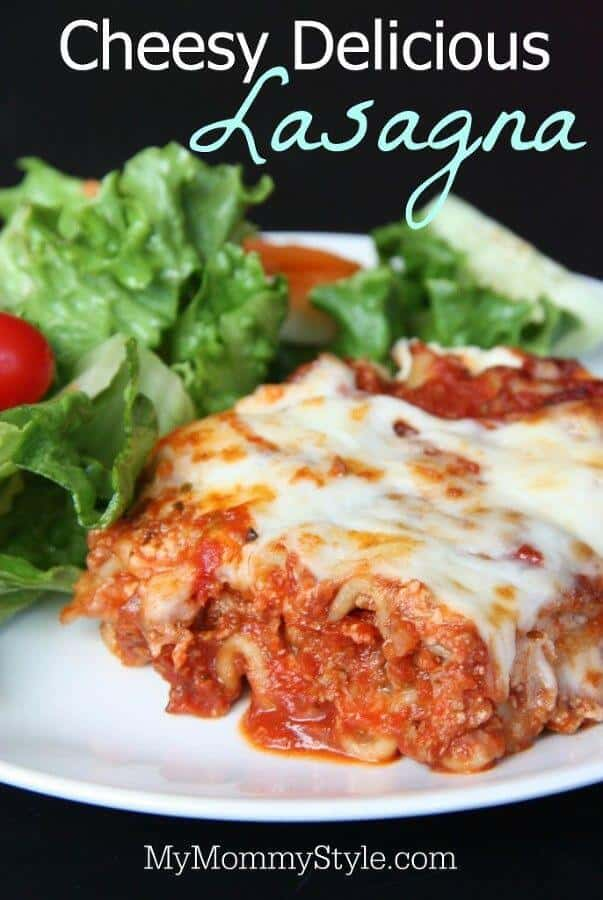 Cheesy Delicious Lasagna -- a classic recipe that's filled with cheesy, creamy, tomato meat saucy goodness that you're whole family will love!   Featured on The Best Blog Recipes