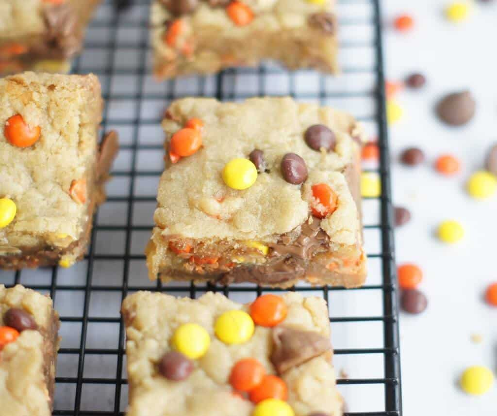 REESE'S PIECES CHOCOLATE CHIP BARS -- are cookies full of Reese's Pieces and chocolate chips and they are so easy to make and oh-so-good! | Featured on www.thebestblogrecipes.com