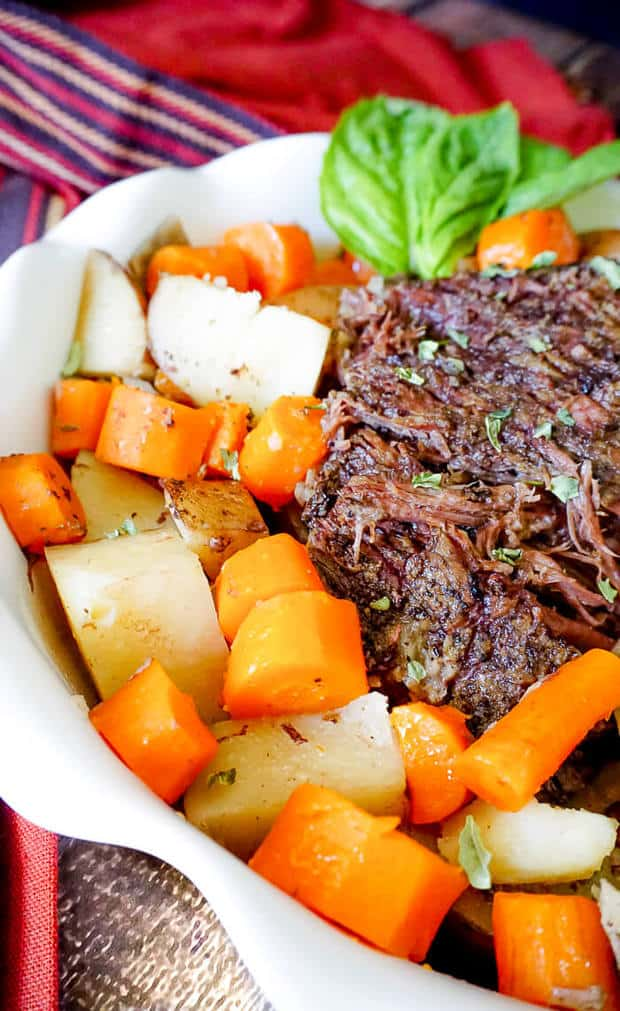 HEARTY SLOW COOKER POT ROAST -- It has everything the ultimate comfort meal needs – a tender cut of meat, potatoes, a vegetable and it's SO easy to make! | Featured on www.thebestblogrecipes.com