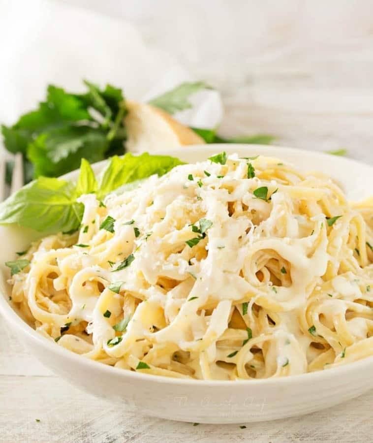 Just a few ingredients make up this luxuriously creamy roasted garlic cream sauce… perfect for dipping or swirled with your favorite pasta!