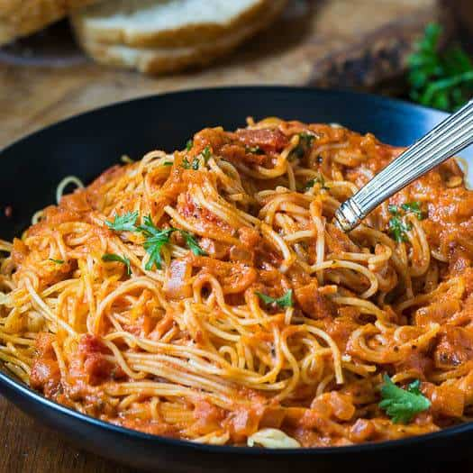 With this simple Spicy Tomato Cream Pasta Sauce, you can have a delicious meal on the table in just a matter of minutes. It involves adding a few ingredients to your favorite spaghetti sauce to turn it into creamy, spicy heaven. Toss it in with some angel hair pasta which I love because it cooks up so fast.