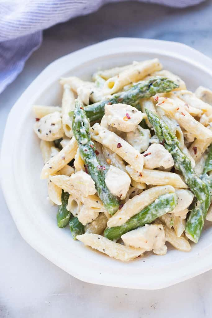 My family loves easy pasta dish made with penne noodles, chicken and asparagus tossed in a creamy Parmesan sauce.