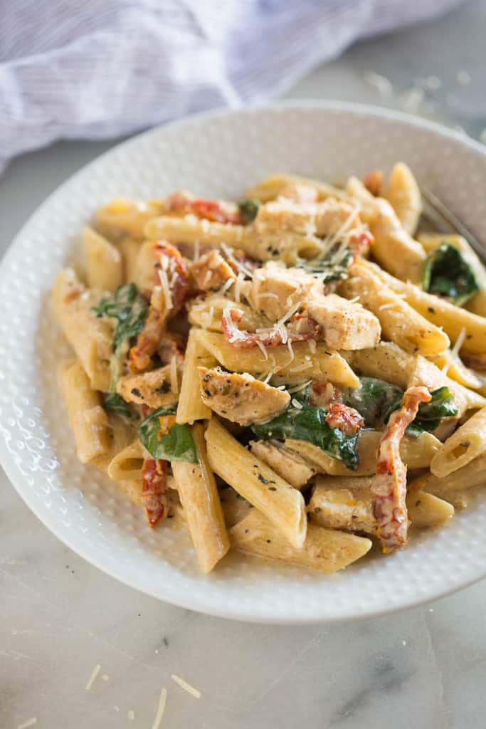 A delicious pasta dish with creamy garlic sauce, sun-dried tomatoes, spinach, and chicken. My family quickly fell in love with this yummy, EASY pressure cooker meal.