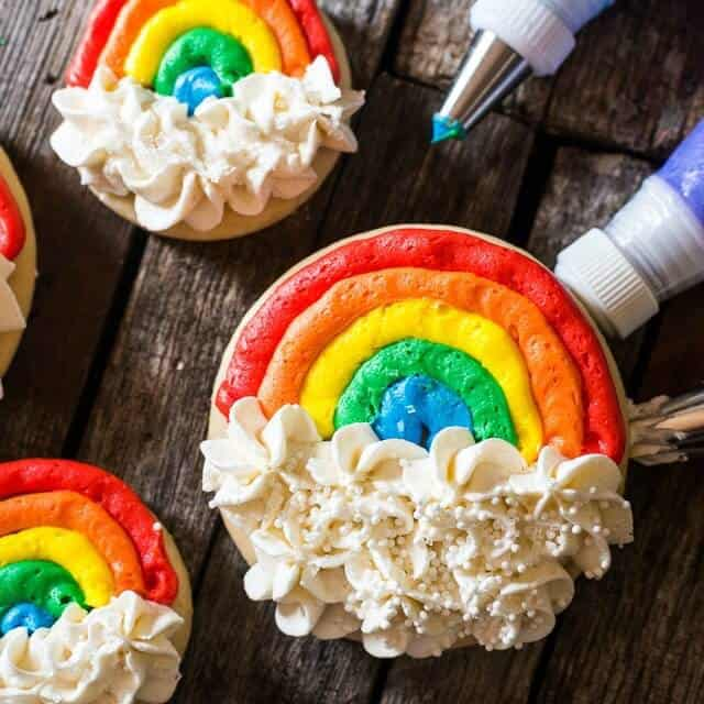 Frosted Rainbow Cutout Cookies -- Soft, Lofthouse-style cutout sugar cookies in simple circle shapes make easy decorated rainbow cookies that anyone can do!