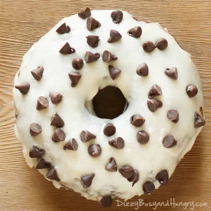 BAKED DOUBLE CHOCOLATE DOUGHNUTS WITH ORANGE GLAZE -- are dipped in a ...