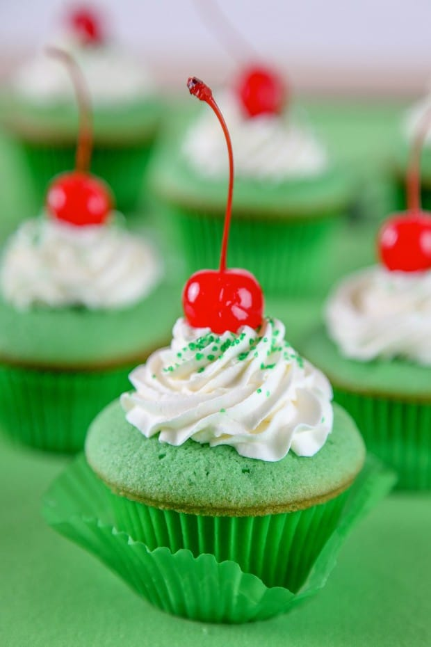 Shamrock Shake Cupcakes Recipe: Moist mint cupcakes topped with  white chocolate whipped cream. Your favorite McDonald's Shake in cupcake form
