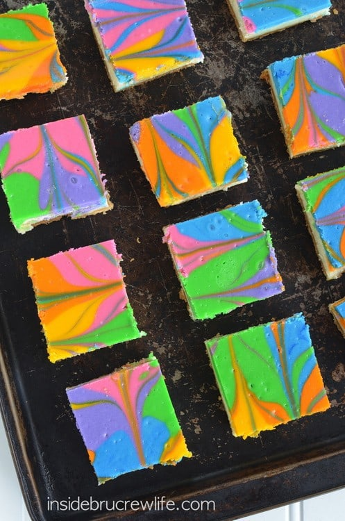 Vanilla Cheesecake Bars with a swirl of rainbow colors is a perfect dessert to serve for any party or event. It is easy to customize it to any theme.