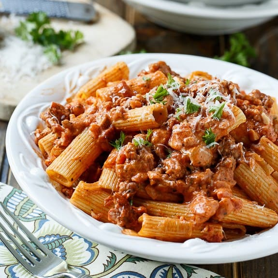 Sausage with Rigatoni in Spicy Cream Sauce is pure comfort food and makes an easy and delicious weeknight meal. The flavor starts with onion and garlic which are sauteed with the sausage for maximum flavor.