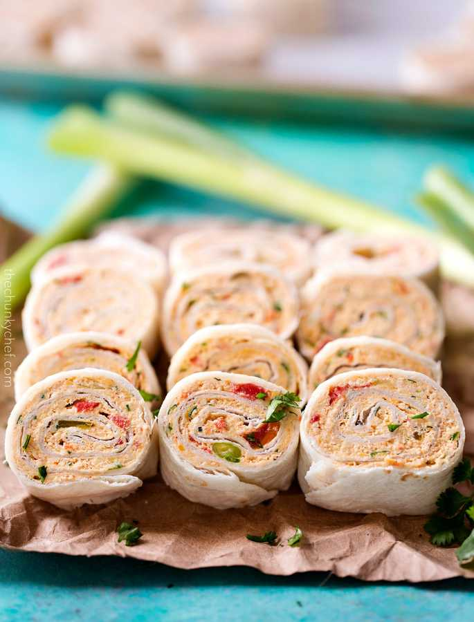 These Mexican pinwheels are perfect for ANY party or get together!  Made with mouthwatering chicken taco flavors, they're a favorite with both kids and adults!