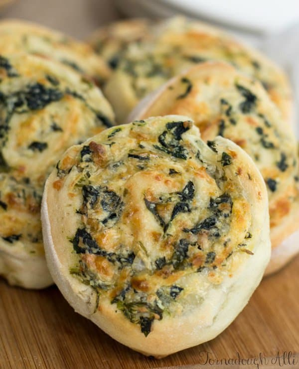 Creamy cheesy spinach is rolled tight in soft fluffy dough to make these Spinach Dip Pinwheels a great appetizer for any party!