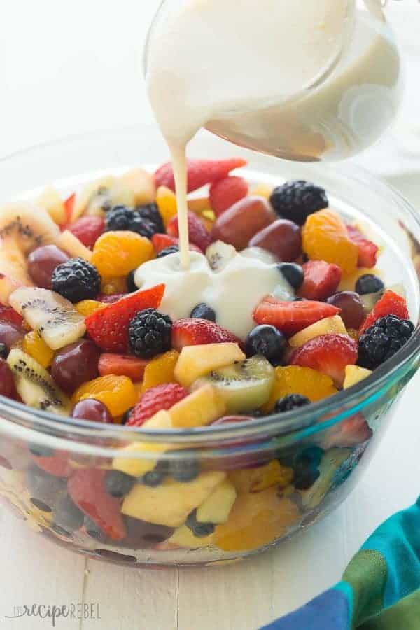 This Creamy Fruit Salad Recipe is made with a Homemade Vanilla Dressing — no pudding mix here! It is the perfect summer breakfast, snack or dessert.