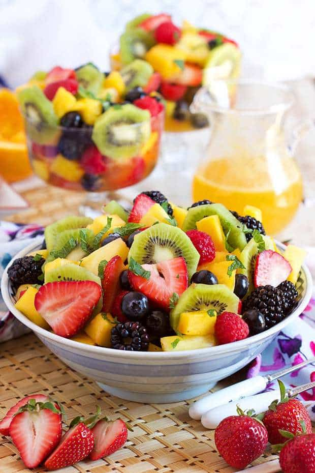 Eat with your eyes, then dig into this refreshing and light Sparkling Fruit Salad with Champagne Mimosa Dressing. The best berries, mango, pineapple, kiwi and mint are tossed together with a bubbly, citrusy dressing that's good enough to drink! Brunch perfection!
