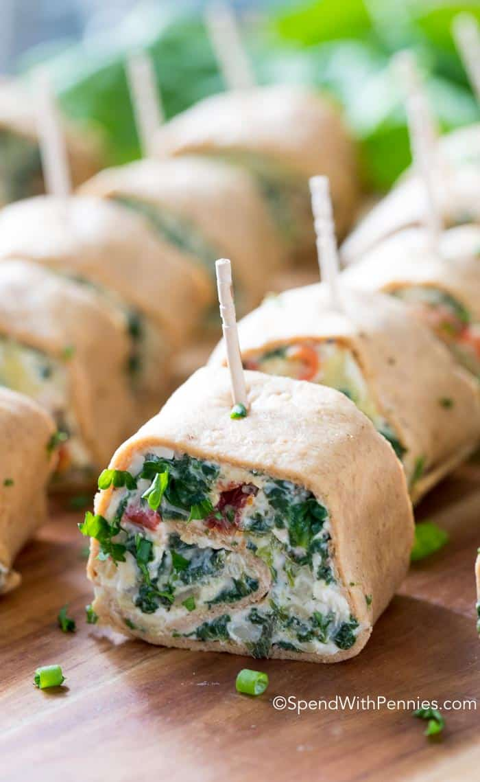 Tender flatbread filled with creamy spinach and artichoke dip and rolled into bite sized pinwheels.