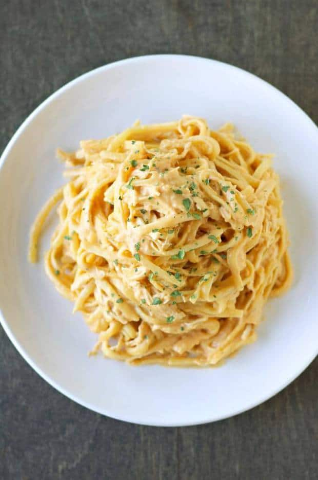 ThisSlow Cooker Cheesy Buffalo Chicken PastafromSlow Cooker Gourmetis delicious, rich, cheesy, creamy and just the right amount of spicy! The best part is that it's made 100% in the slow cooker for an easy dinner recipe that your whole family will love!