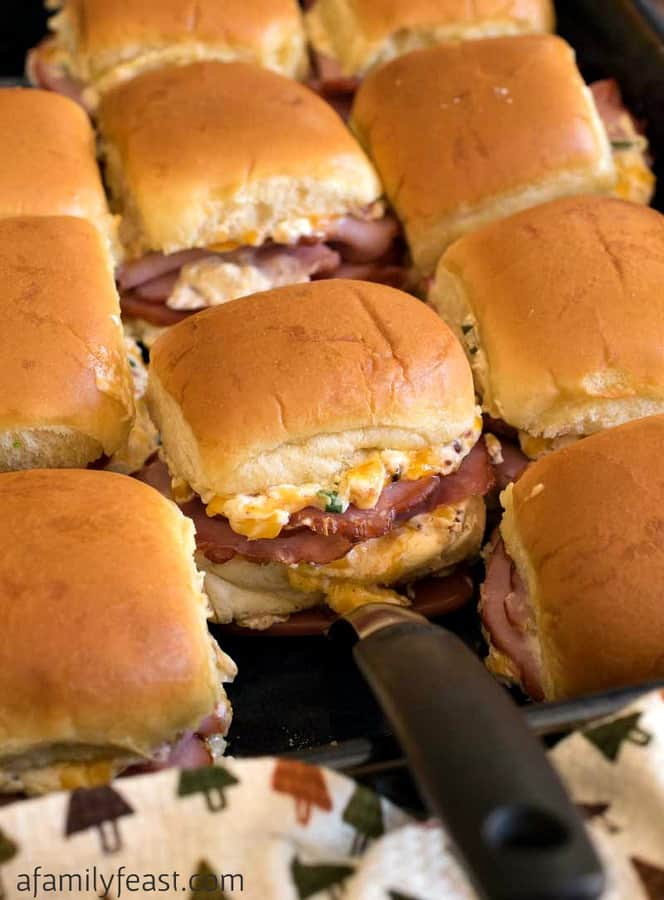 Our Mississippi Sin Ham Sliders can be made ahead of time – then warmed up in the oven when guests arrive. This dish even travels well – simply assemble the sliders right in a baking pan and heat them when you get to the part