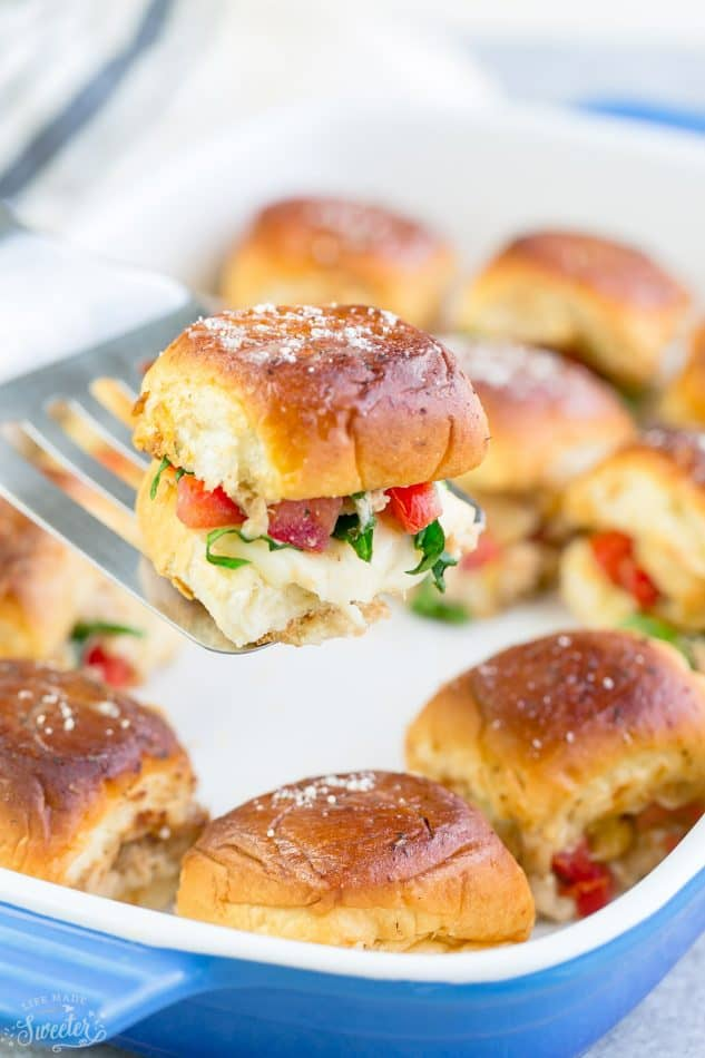 Italian Chicken Bruschetta Sliders are the perfect easy appetizers for feeding a crowd. Best of all, they come together in less than 30 minutes with tender chicken, juicy tomatoes and gooey cheese.
