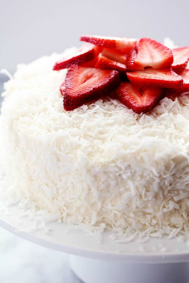 STRAWBERRY COCONUT CREAM CAKE WITH COCONUT CREAM CHEESE FROSTING--31+ COCONUT DESSERTS THAT WILL SATISFY YOUR SWEET TOOTH!
