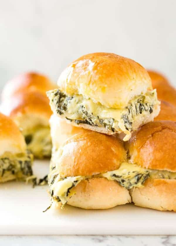 A total crowd pleaser! These Spinach Artichoke Dip Sliders are a great way to feed a crowd because you can make loads in one go. Warm and buttery, stuffed with Spinach Artichoke Dip and extra cheese…. I bet you can't stop at one