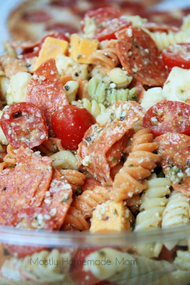 This Pepperoni Pizza Pasta Salad features tri colored rotini pasta with pepperoni, mozzarella, cheddar, and tomatoes in a Parmesan vinaigrette. This Italian pasta salad variation is the perfect summer side dish recipe!
