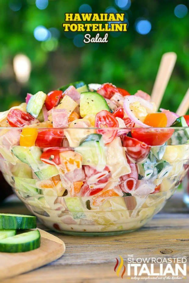 HaHawaiian Tortellini Salad is a like a party in your mouth! It's a blend of your favorite island flavors in a fabulously bright, sweet and tangy summer pasta salad. A simple recipe with an outstanding pineapple-ginger dressing, this will be a hit everywhere you take it.