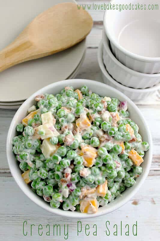 This Creamy Pea Salad is sooooo easy and it's always a hit! I've had this in my recipe file for more than 20 years and I can't tell you how many times I've given this recipe to friends and family! I've even had people who swear they don't like peas, enjoy this Creamy Pea Salad – it's that good!
