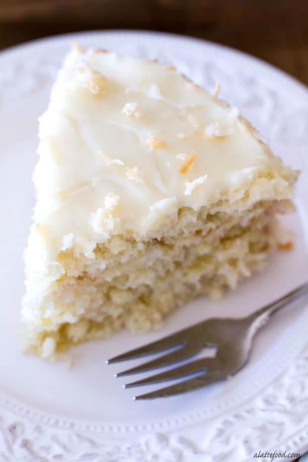 Classic Coconut Cake: This triple layer cake is filled with delicious coconut flavor and topped with a to-die for cream cheese frosting! This cake is simple yet a total crowd pleaser!
