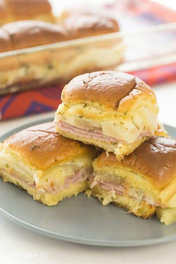 These Hawaiian Ham and Pineapple Sliders are an easy appetizer, lunch or dinner with just a few ingredients. Perfect for a potluck barbecue, game day or a fun weeknight meal!