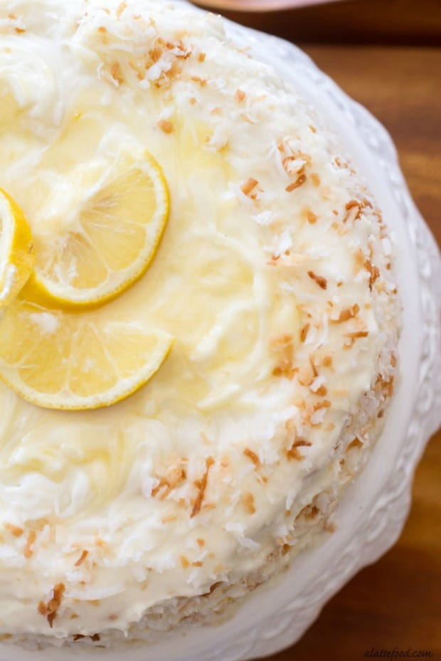 Lemon Coconut Cake: This classic coconut cake is filled lemon curd and topped with a lemon cream cheese frosting!