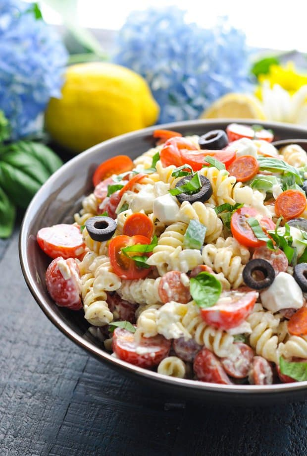 Full of fresh, flavorful ingredients, this Creamy Italian Pasta Salad is a quick and easy dish for picnics, potlucks, or light and satisfying dinners.