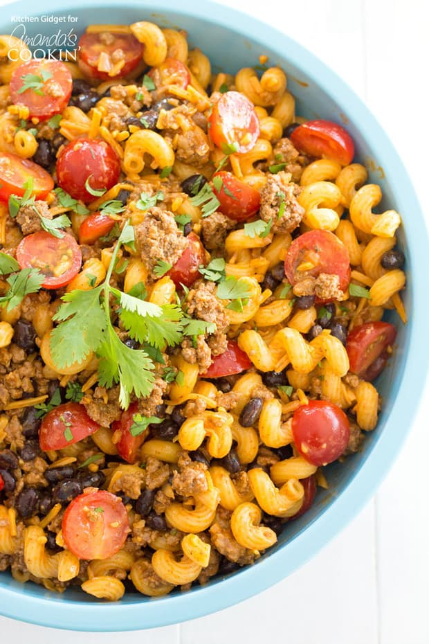 If you love taco salad than this taco pasta salad is for you! It's loaded up with ground beef, juicy tomatoes, black beans and lots of cheese. Take it to the next level with your own homemade taco seasoning!